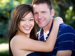 asian woman and white male couple