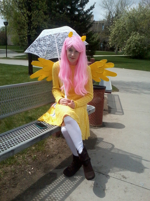 "A young girl dressed in a costume designed to look like the character ""Fluttershy."""