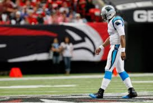 A dejected Cam Newton, knowing that he will no't likely be on any of FF Commish's teams