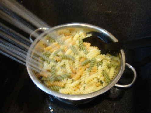 "Rinsing pasta with cold water stops it from cooking any further, keeping it firm or ""el dente,"" meaning just right."