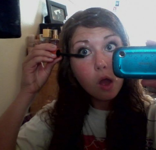 Attempting a picture of applying mascara