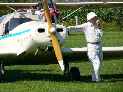 Private Pilot Stands With Plane