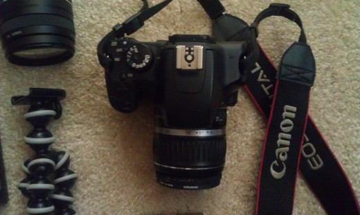 Top picture of my Canon with spot for the flash, mode dial, and iso button