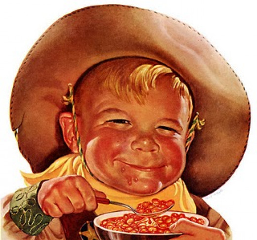 Cute little boy in cow boy hat eating pork and beans