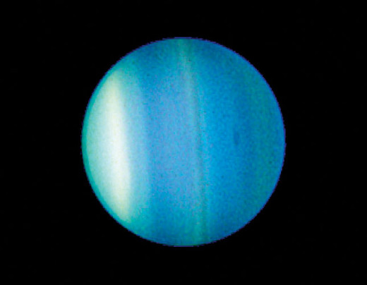 Color-enhanced view of the planet Uranus as seen by the Hubble Space Telescope. (Without upping the color contrast, it's a fuzzy blue ball the color of a robin's egg.)