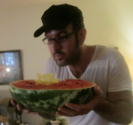 My brother's July birthday with candle in a watermelon