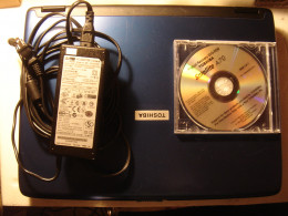 With OEM AC Adapter and Recovery DVD