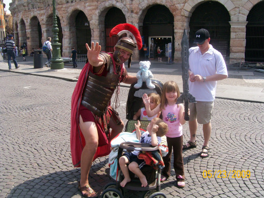 A Gladiator posing with the kids in front of the Arena