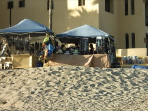 These vendors have their own mini-stores in tents on the beach.