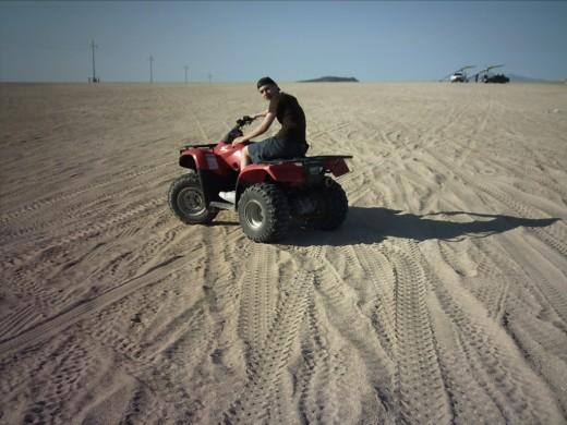 While my wife napped at the condo my son & I headed up the road a ways where we rented the ATV to drive around the dunes.