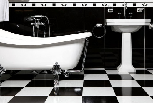Retro Bathroom with Clawfoot Bathtub and Pedestal Sink