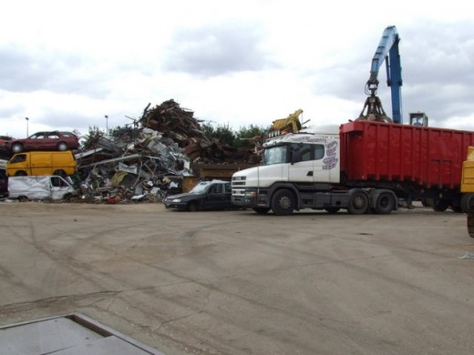 A scrap yard with a whole bunch of junk piled up!