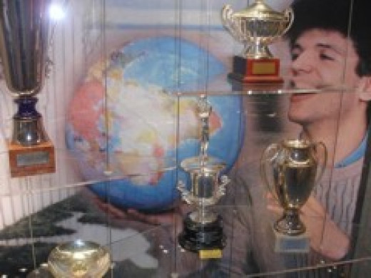 Young Dražen admiring the trophies that he has so far accumulated.