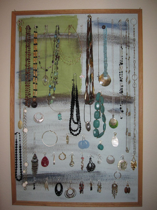 A painted corkboard turned into a jewelry organizer