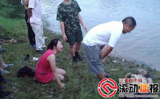 Deng's sister Qiuqiong mourns over the lifeless remains of his brother