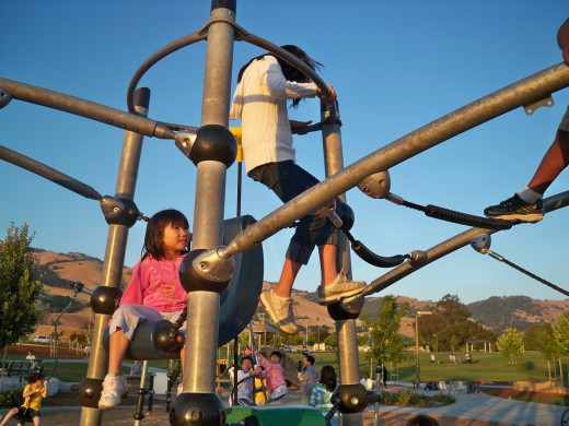 Kids Climbing on Play Structure