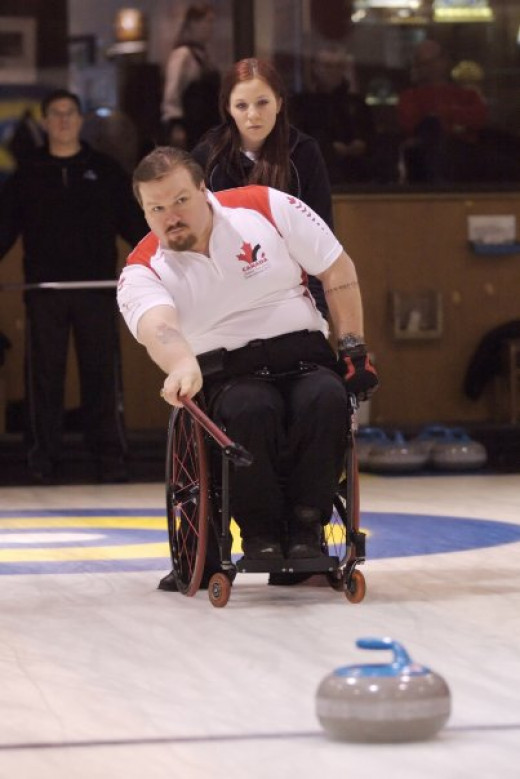 Chris Daw curling, 2006 Paralympic Gold Medallist. Photo by Arowyndaw. License: CC-BY-SA 3.0.