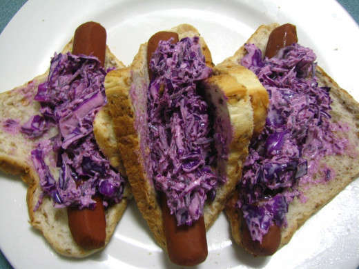 Purple coleslaw hot dogs, I love the color contrast.