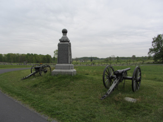 Cannons and monument at the Peach Orchard on the Gettysburg battlefield