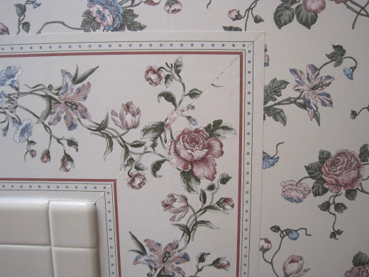 Nice white tile next to old wallpaper.