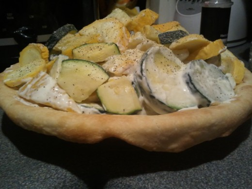 Be sure to fill in pie crust. Piles up high but lowers as squash and zucchinis soften.