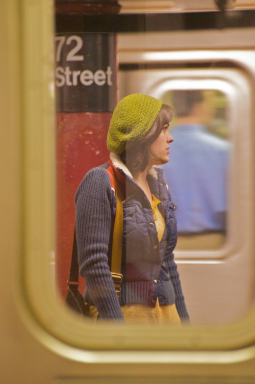 The subway window used to frame this image gives it context as you know exactly where she is and what she's doing, whereas, in a close up portrait you would not have this understanding