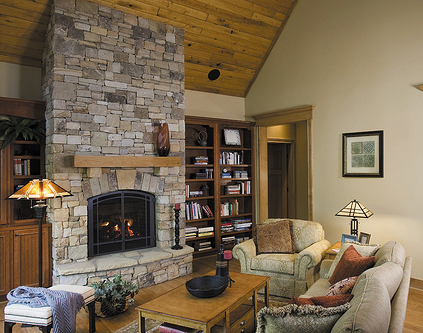 A stone fireplace makes a statement in rustic cottage design.
