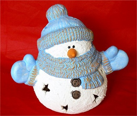 Snowman dress up race game