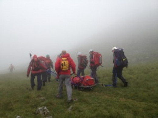 The Wasdale Mountain Rescue Team brings an injured climber down Scafell Pike