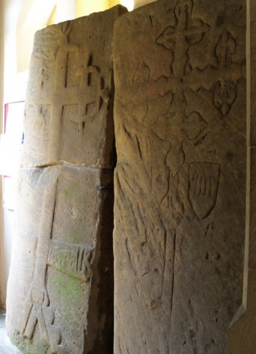 Ornate slabs in the church porch, showing floriate arms of the Percy family who owned much of the land in North Yorkshire up to Henry VIII's reign