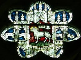 Stained glass image of 'the lamb of God' -  lamb is a major element of the local economy