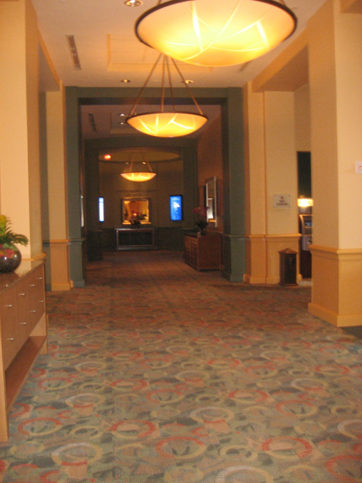 The lobby corridor leading to the elevator.