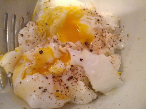 Poached eggs seasoned with salt and pepper