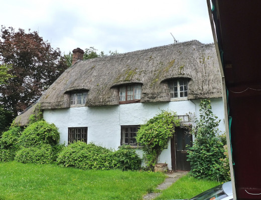 Beautiful thatched cottages on route, these photos were taken from the caravan.