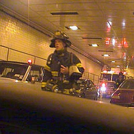 Gary Box (35), firefighter with Brooklyn's Squad 1, was captured on camera lugging his gear through a traffic-clogged Brooklyn-Battery Tunnel on his way to Ground Zero, Sept.11. He died an hour later in One of the Towers.