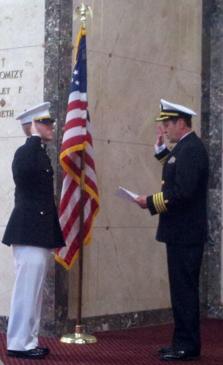 Retired U.S. Navy Captain and family friend administering the Oath to Andy