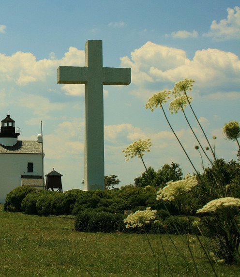 The commemorative cross on St. Clement's Island honoring the first Marylanders stands near Blackistone Lighthouse.