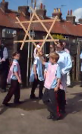 Goathland dancers holding the locked swords aloft