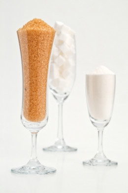 Various types of sugar and sweetener in glasses