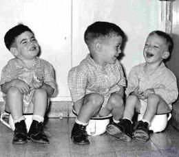 Kibbutz children sitting on chamber pots
