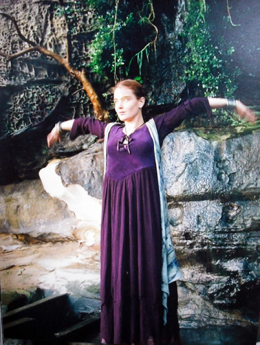Wiccan in a Long Purple Gown and Vest