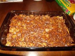 Chex mix squares ready for the refrigerator.