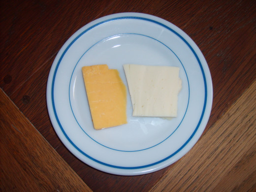 The cheese on the left is a tasty cheddar and on the right is a nice white cheese.