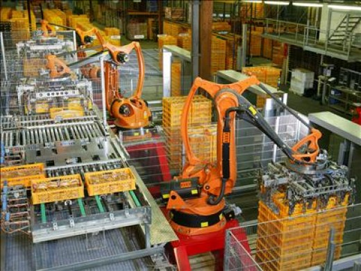 These robots are working in a bakery packaging plant, doing the job perhaps better than you could???