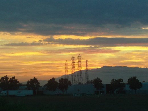 Pylons are silhouetted against the brilliant sunset.