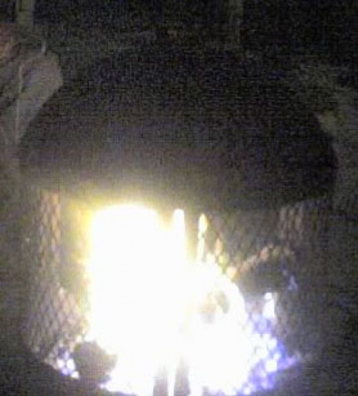 A fire in an outdoor fireplace
