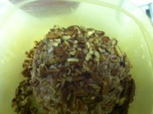 Roll the cheese ball in pecans.