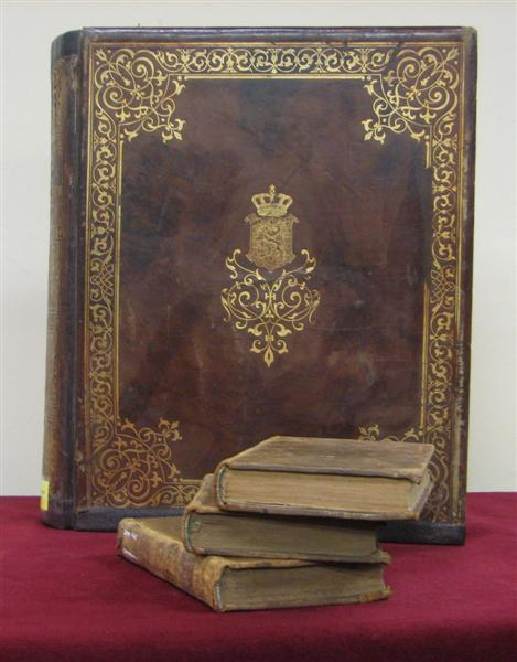 Leather bound book lavished in gold.