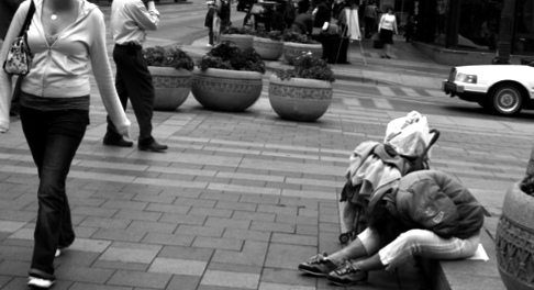 Interesting shot of a fashionable woman walking by a homeless woman. I have an affinity for the homeless. Had things been a bit different, I could have been one of them.