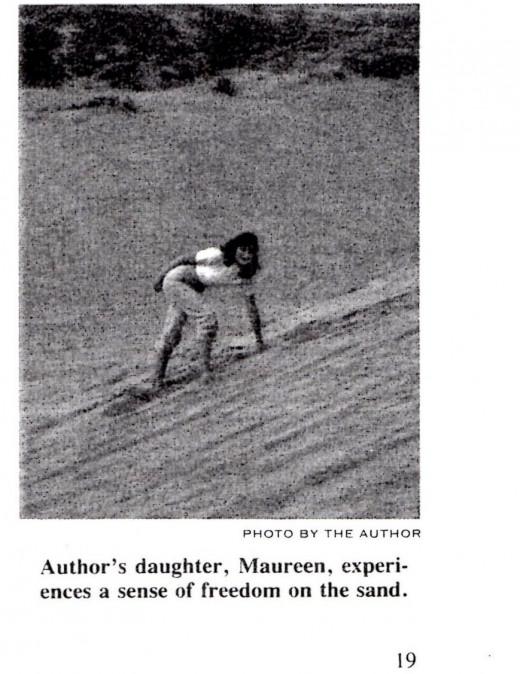 My daughter Maureen climbing a dune